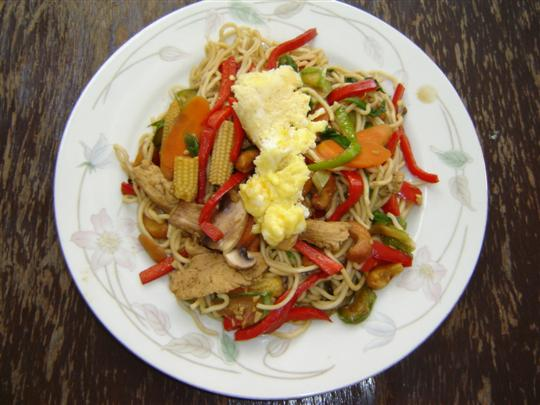 cooked stir fried chicken and vegetables with noodles. Last night ...
